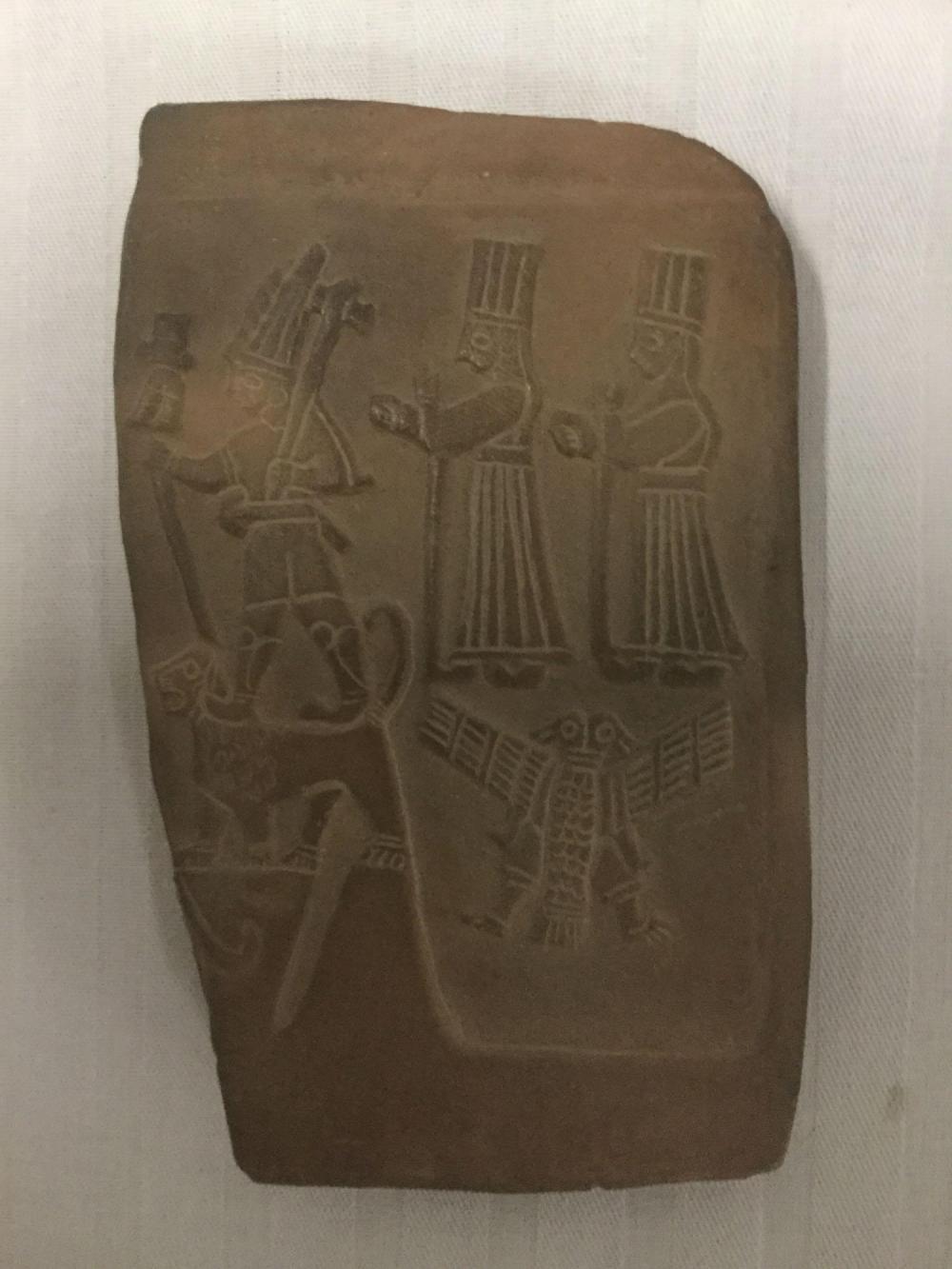 Lot 186: Contemporary carved relief tile - signed Ibrahim 1999