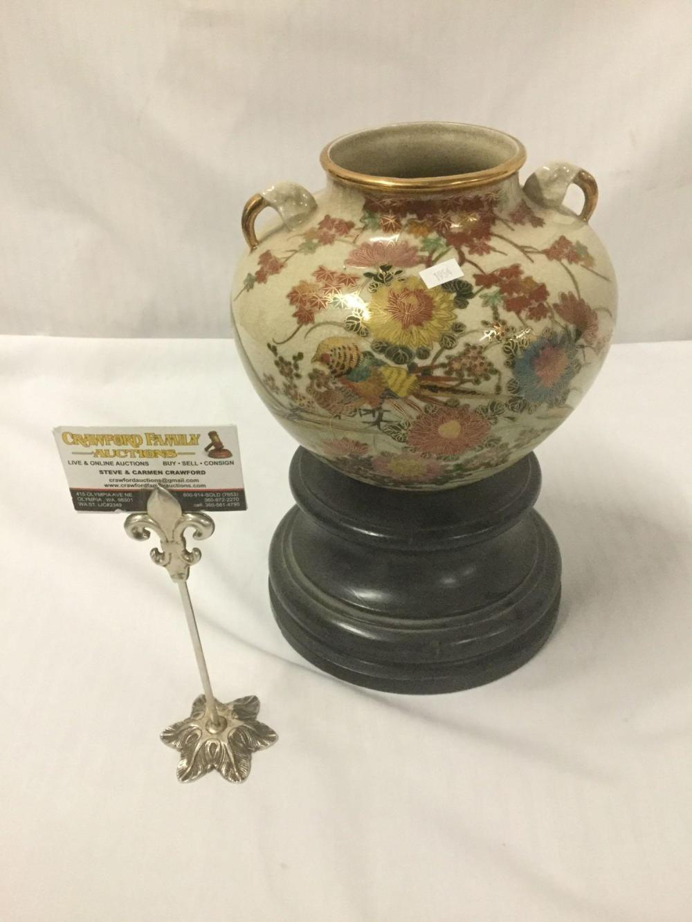 Lot 187: Famille rose Cloisonne porcelain vase with twin handles and gilt accents on a wood base