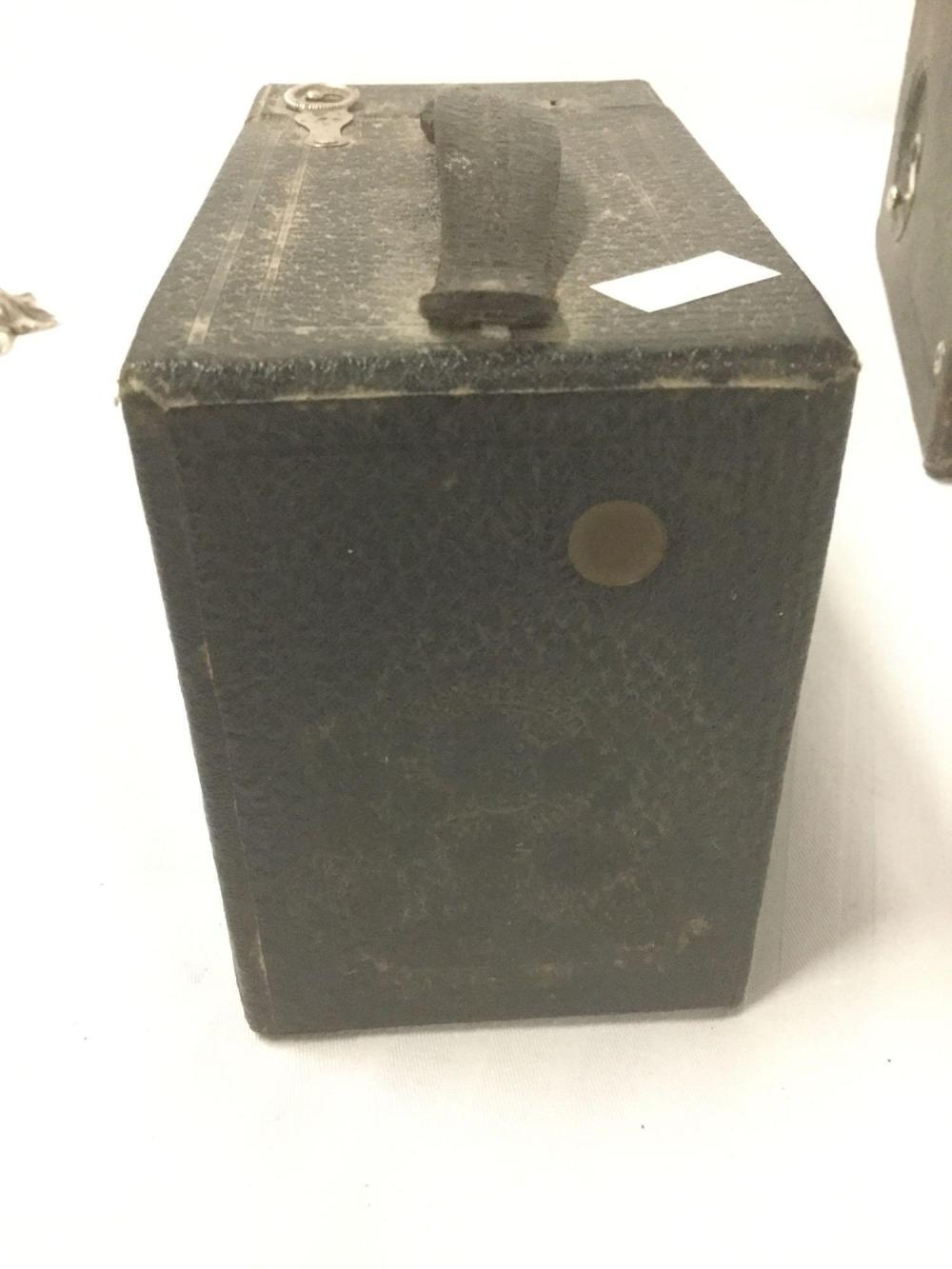 Lot 191: Pair of vintage box cameras, an Eastman Kodak 120, and an unnamed camera