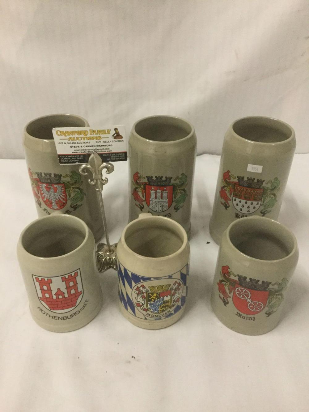 Collection of stoneware salt glaze steins having German city coat of arms design