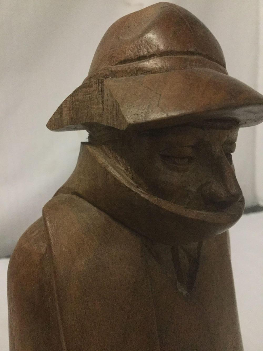 Lot 199: Hand carved wood statue of man with scarf. Marked G.A. 300 dollars 11 - Has chip in hat