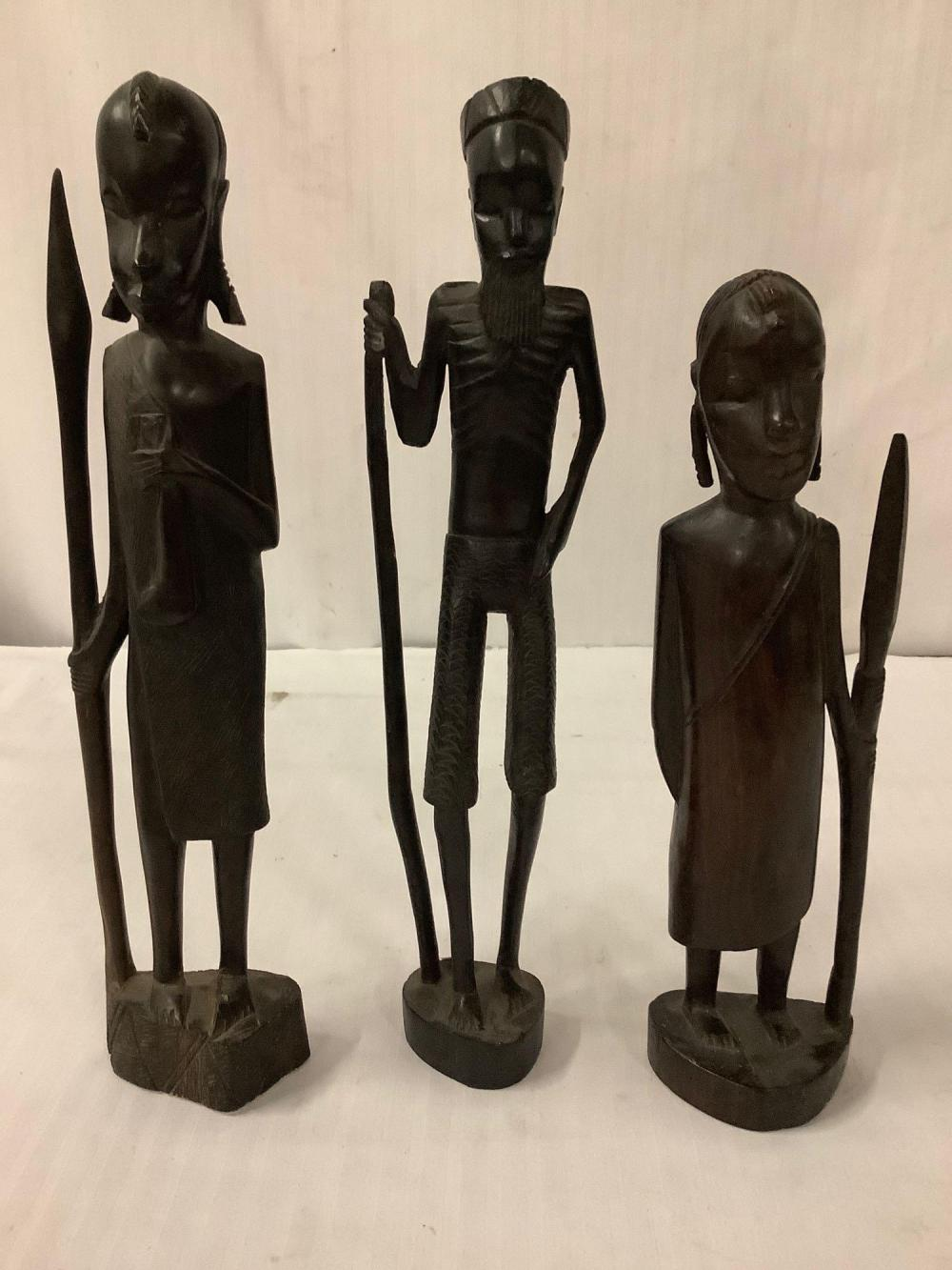 Lot 198: 3 hand carved African wood figure statues - classic tribal depiction
