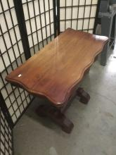 Lot 328: Antique hall table with folding top the folds in to desk and trestle style base