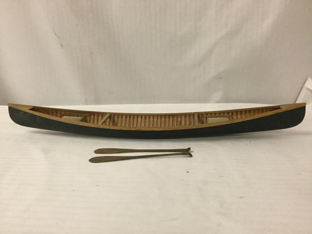 Lot 320: Vintage model canoe with a pair of wood carved paddles