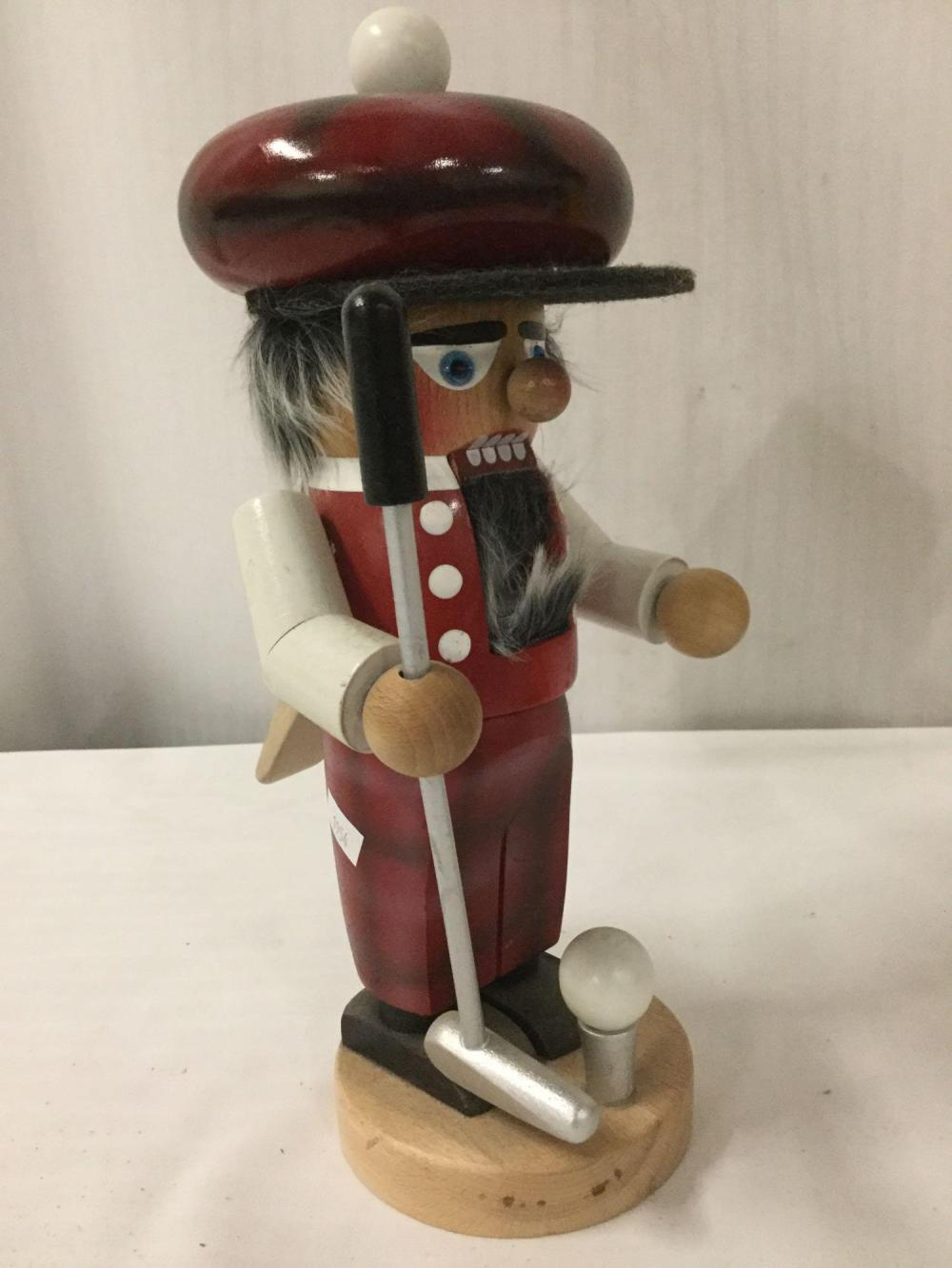 Lot 373: Lot of 2 decorative nutcrackers - Golfer is Steinbach & JP Patches by Bartell Drug Co