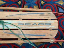 Lot 400: Antique wood and metal Sears snow sled