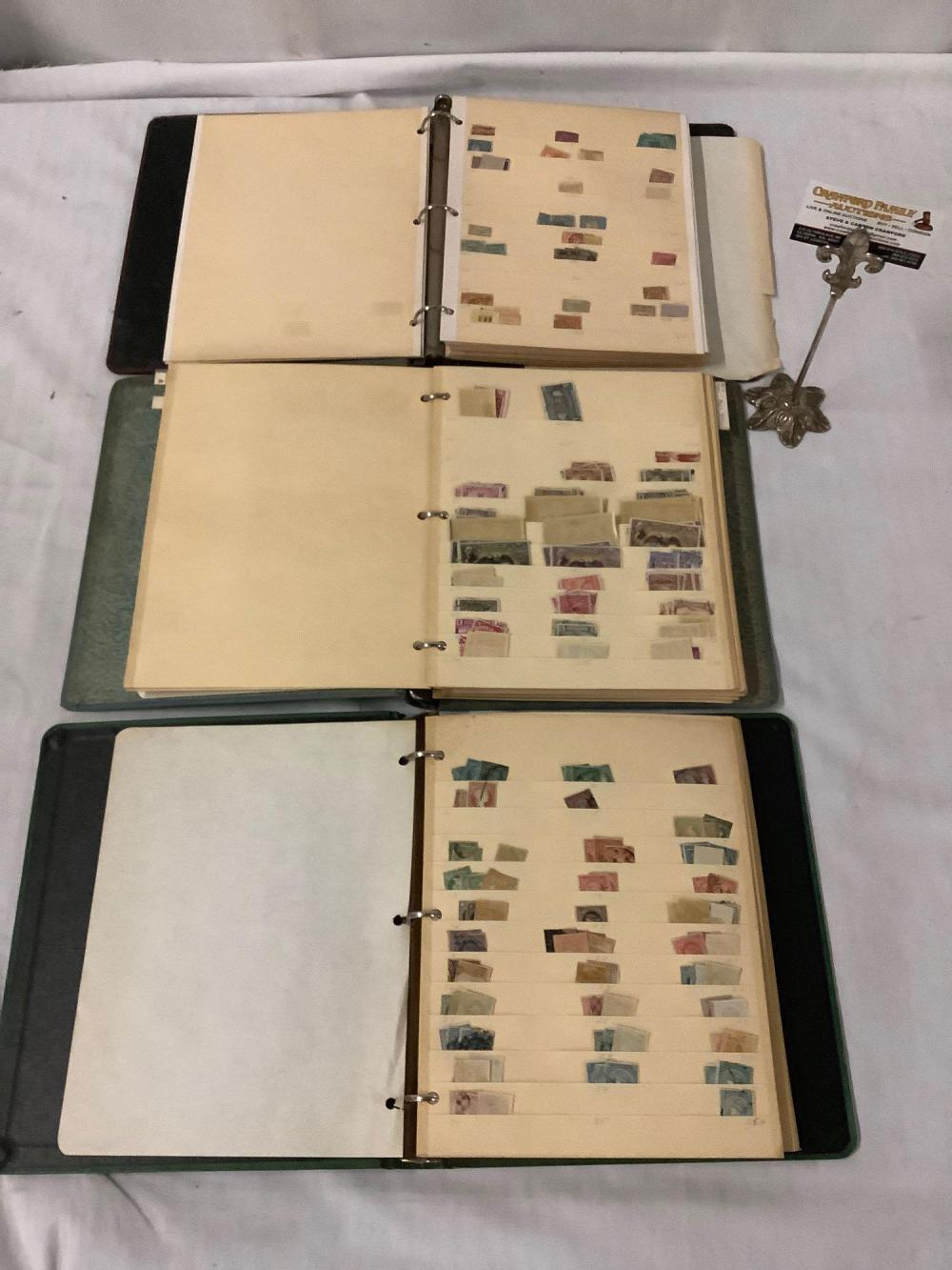 Lot 357: 3 binders full of antique stamps from Cuba, Ecuador and Columbia, dating back to 1930s