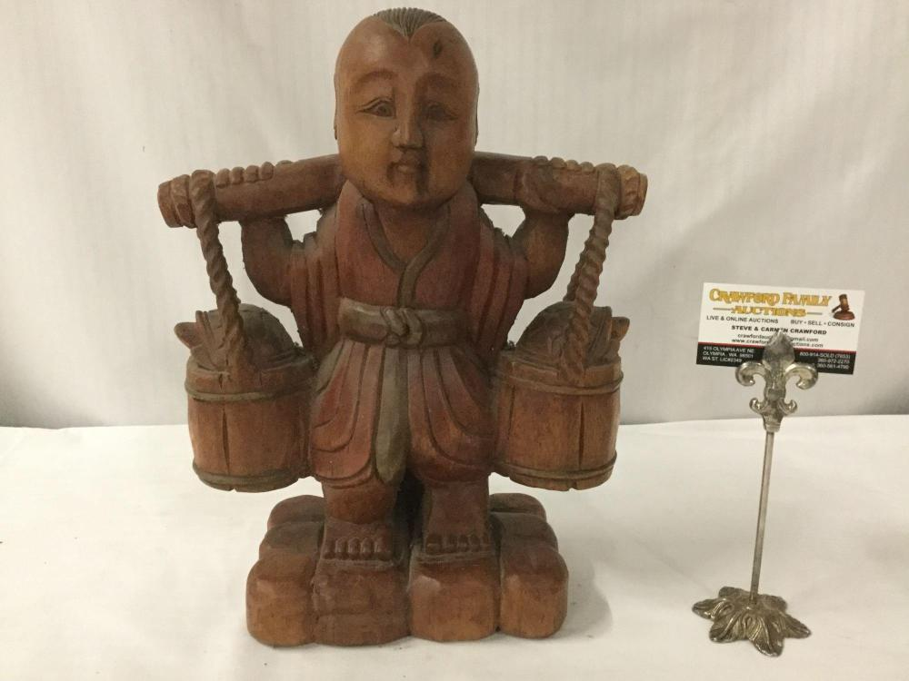Lot 388: Antique wood carved Asian figure/ statue with incised designs, boy carrying water buckets