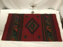 Lot 315: Native American woven red base rug / tapestry with traditional design