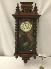 Lot 380: Antique wood carved wall clock w/ neoclassical design - Roman Numeral face, key and pendulem - see