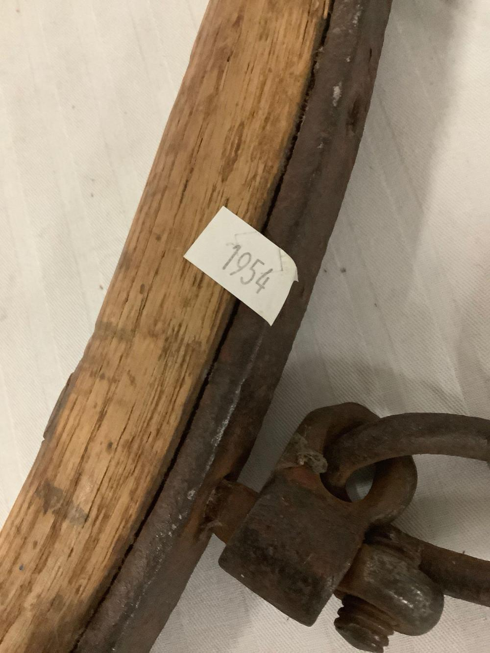 Lot 399: Antique wood and metal livestock harness piece