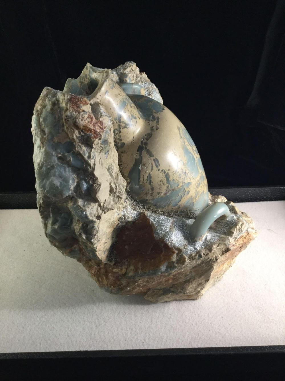 """Lot 395: Large and very unique carved stone jar displayed as a """"in situ"""" ancient archaeological find"""