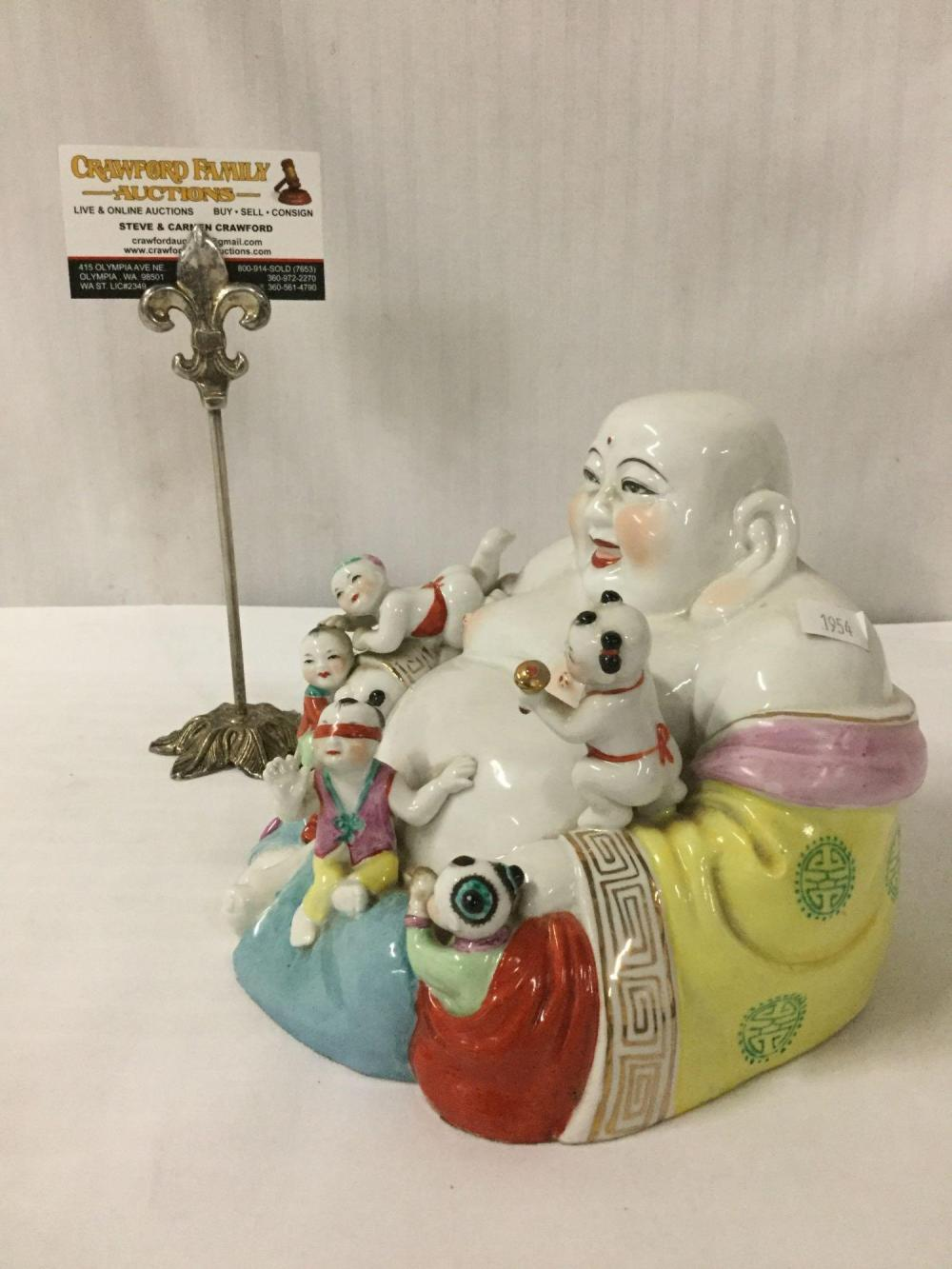 Lot 396: Porcelain Buddha statue with painted accents , Buddha story teller