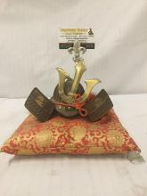Lot 213: Vintage Japanese metal and brass kabuto samurai helmet sculpture on pillow