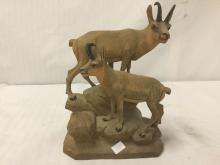 Lot 214: Pair of animal statues - A Resin buffalo with a broken horn, and a pair of wooden mountain goats