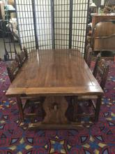 Lot 222: Vintage rustic dining table with trestle base and 4 wicker seat carved chairs