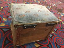 Lot 229: Small antique hand carved upholstered ottoman with storage