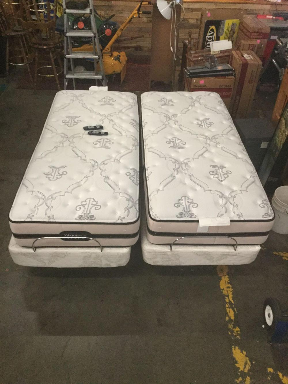 Lot 232: Beauty Rest black double twin mattresses with electric raising and massaging frame and remotes