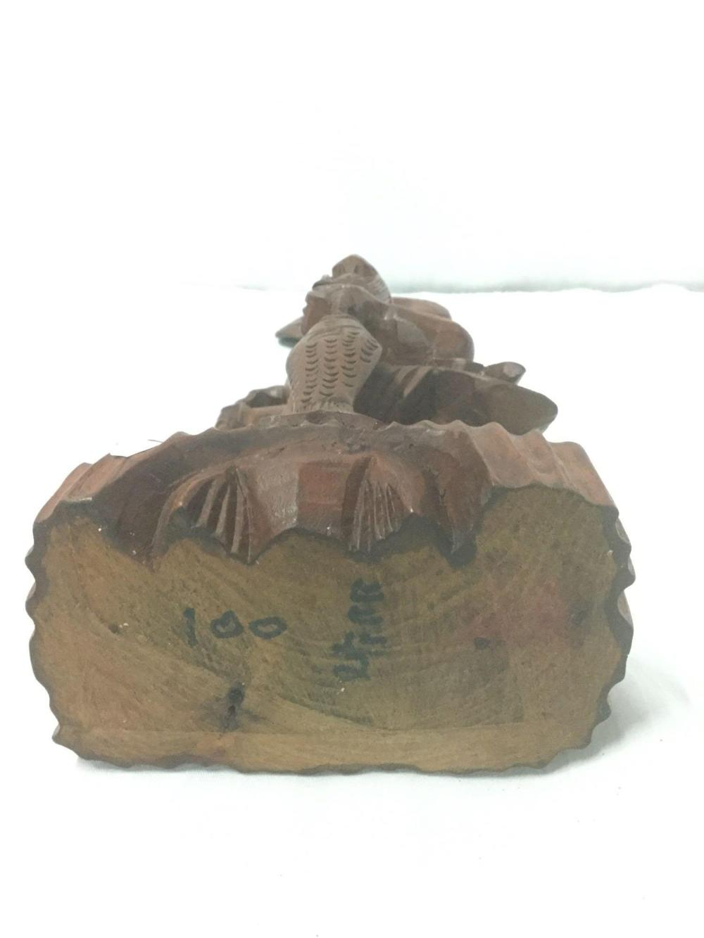 Lot 242: Chinese hand carved wood figural statue of laughing old man with fish. Signed by Artist