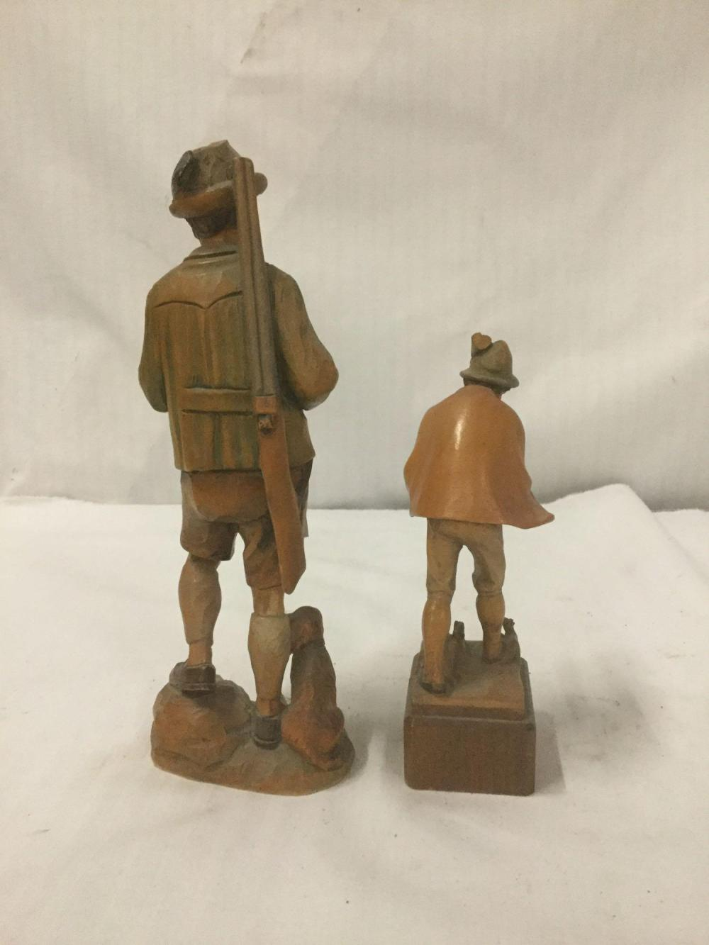 Lot 243: 2 vintage Swiss carved wood statues by Schmid-Linder Boy playing a flute, hunter with pipe etc