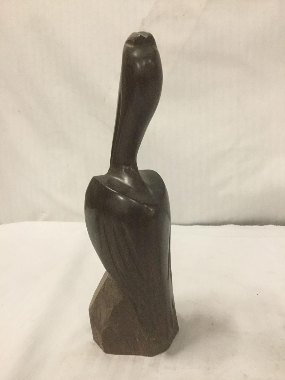 Lot 248: 2 hand carved wooden bird statues - heron and flying bird