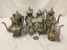 Lot 251: 9 Silverplate teapots, by all different makers - Reed & Barton, Rogers, Crescent, etc - one has
