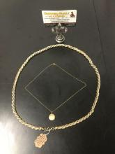Lot 261: Trifari gold tone 14 inch necklace w/ faux pearl & 1940s gold-filled 14 karat locket necklace