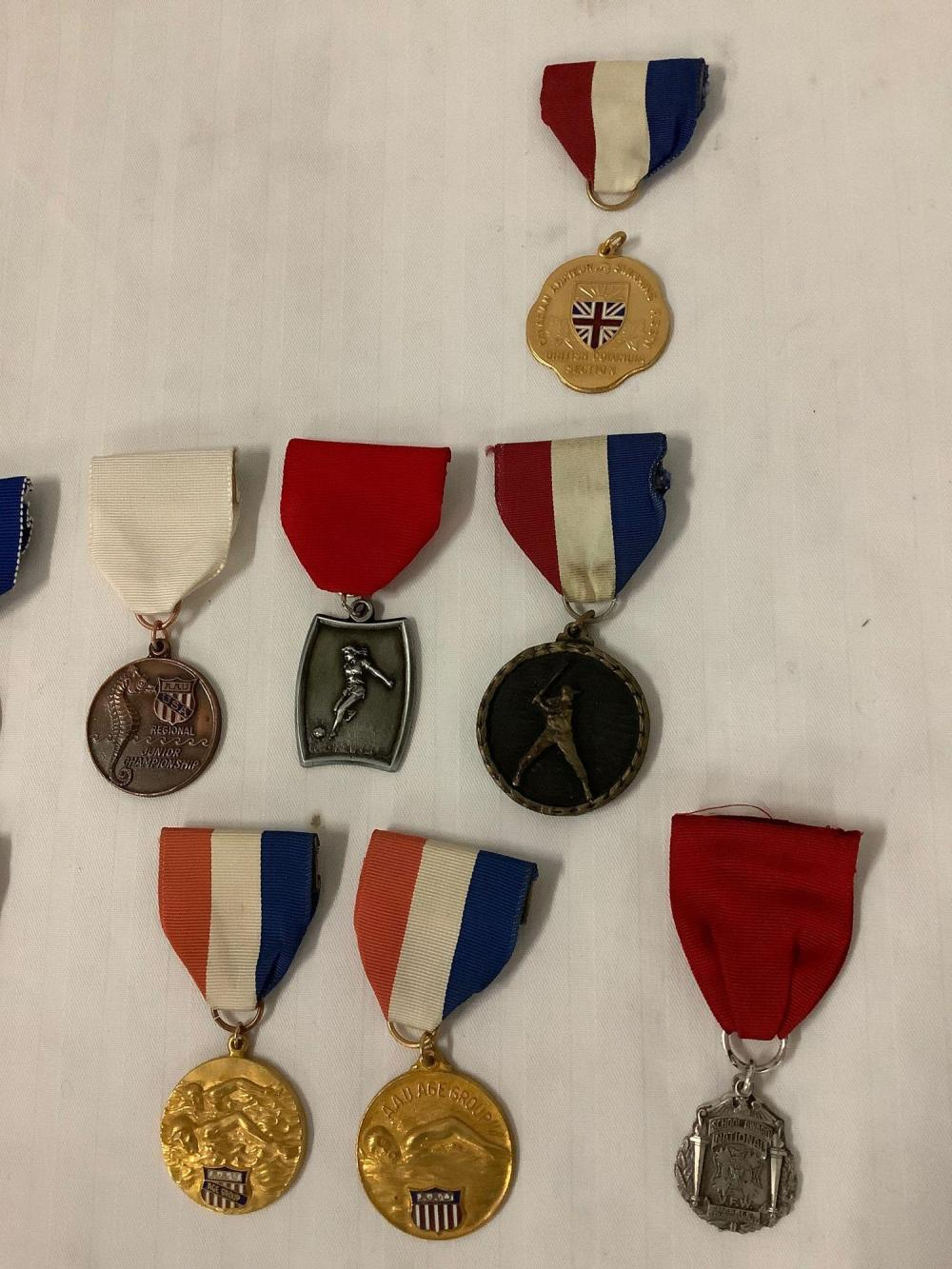 Lot 271: 15 vintage sports achievement medals - AAU Regional Junior champ swimming, womens soccer etc
