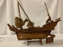 Lot 280: Vintage wooden ship model with stand and cloth sails - needs re-strung to hang sails