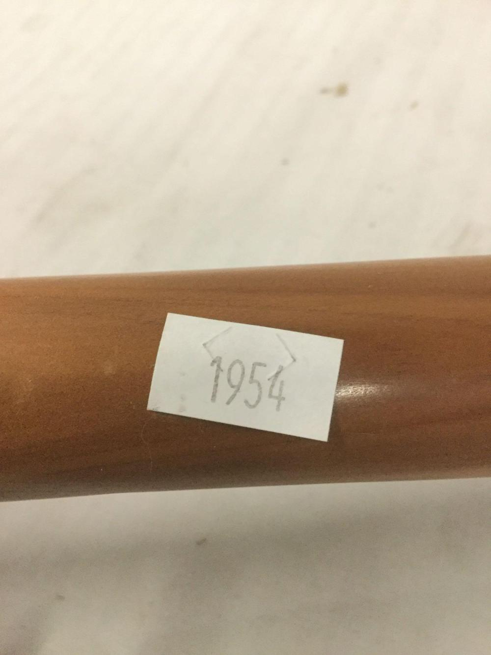 Lot 299: Hand carved Native American Eagle Flute w/ small turquoise inlay - signed Bobby 7794 Nava Hopi