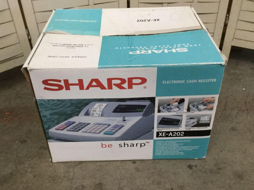 Lot 292: Sharp XE-A202 Electronic Cash Register in Original Box. Works