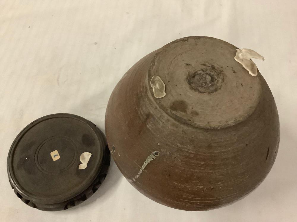 Lot 290: Primitive / antique ceramic pot with two tone drip glaze and wood base
