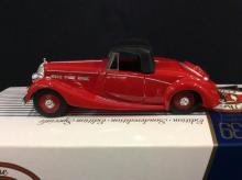 A 1938 Triumph Dolomite die-cast car by Dinky in box.