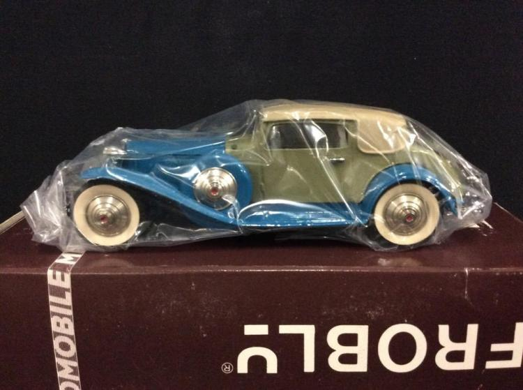 A 1930 Cord L29 coupe die-cast car by Frobly