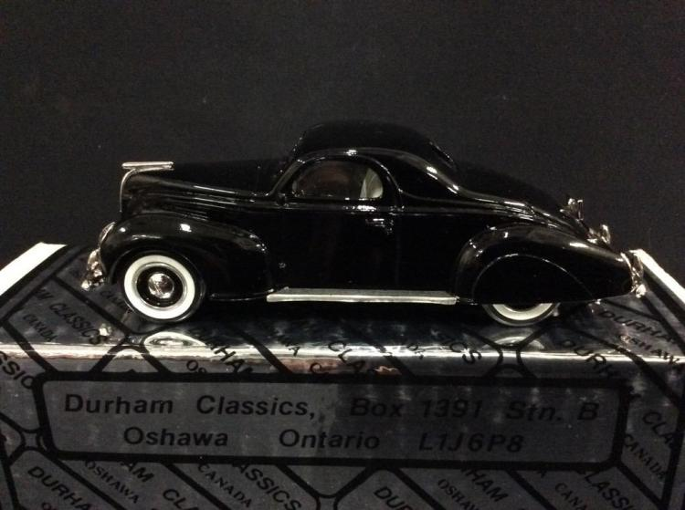A 1939 Lincoln Zephyr die-cast car by Durham classics.