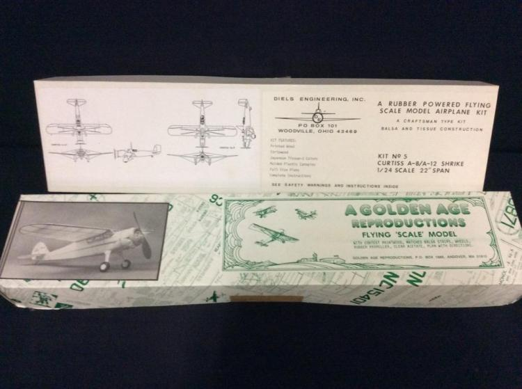 2 balsa and tissue rubber powered airplane kits for the experienced modeler.