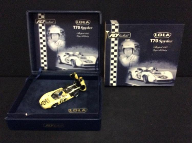 A limited edition 1967 Lola T-70 Spyder die-cast car by fly models.
