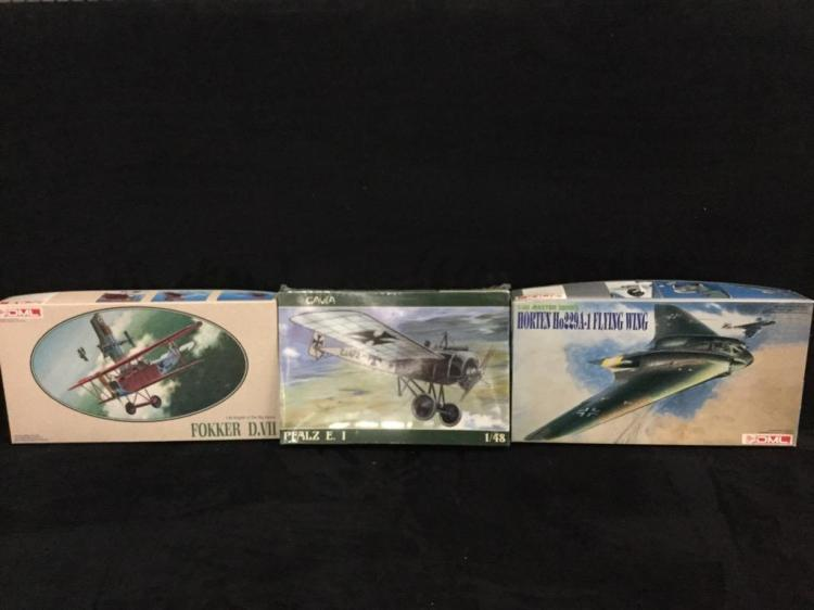 2 DML plastic airplane kits and 1 Cavia plastic model airplane kit