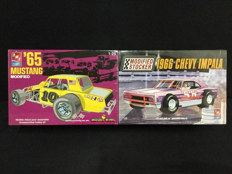 1 1965 Ford Mustang model kit and 1 1966 Chevy Impala model kit