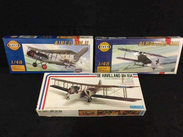 2 Smer model airplane kits and 1 Aurora model airplane kit