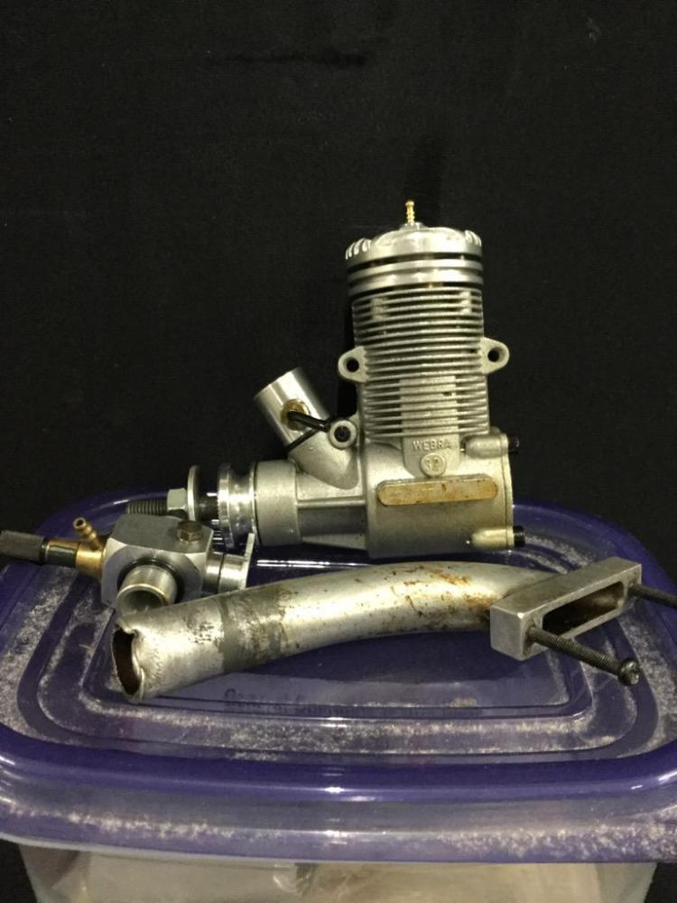 A Webra .32 control line and r/c 2 stroke motor, like new.