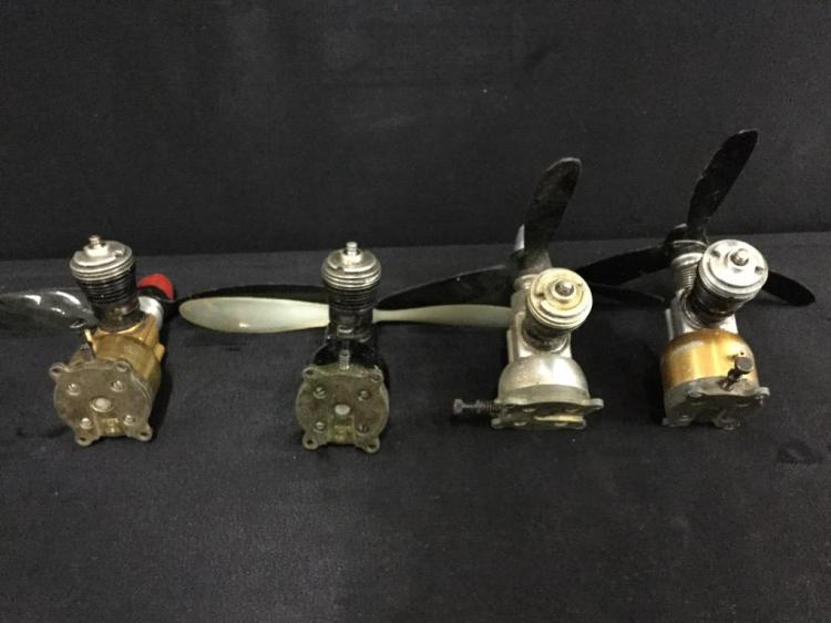 A collection of 4 Cox .049 airplane motors in good condition