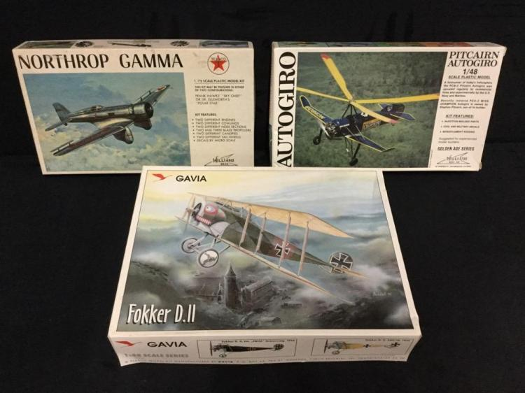 2 1:48 scale model airplane kits and 1 1:72 scale model airplane kit