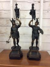 Pair of vintage metal roman soldier statues on wood bases