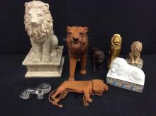 Selection of Lion/tiger decor including leather, wood, stone statues