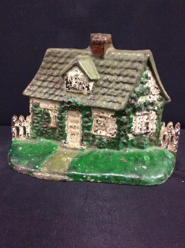 Great handpainted cast iron cottage door stop in good cond