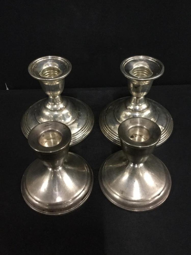 two sets of sterling silver weighted base candlesticks