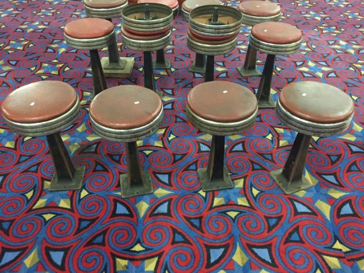 Set of four retro vinyl, chrome and iron stools from portland iron works