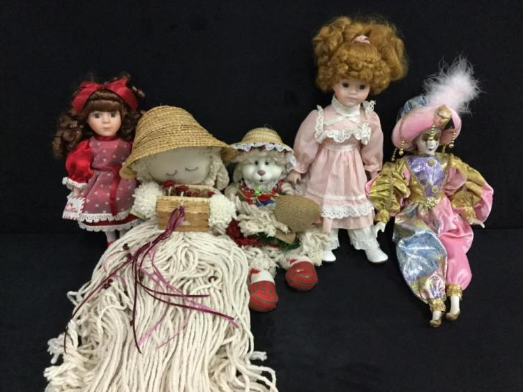 Selection of various porcelain faced and cloth dolls