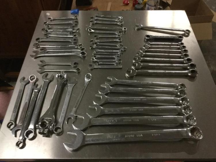 A large selection of S.A.E. and metric wrenches including a set of ratchet wrenches